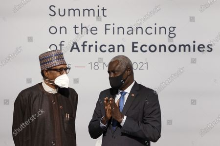 Nigeria's President Muhammadu Buhari, left, speaks with African Union (AU) Commission Chairman Moussa Faki before the opening session at the Summit on the Financing of African Economies in Paris. More than twenty heads of state and government from Africa are holding talks in Paris with heads of international organizations on how to revive the economy of the continent, deeply impacted by the consequences of the COVID-19 pandemic