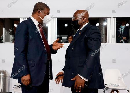 Angola's President Joao Lourenco, left, and Ghana's President Nana Akufo-Addo chat before the opening session at the Summit on the Financing of African Economies in Paris. More than twenty heads of state and government from Africa are holding talks in Paris with heads of international organizations on how to revive the economy of the continent, deeply impacted by the consequences of the COVID-19 pandemic