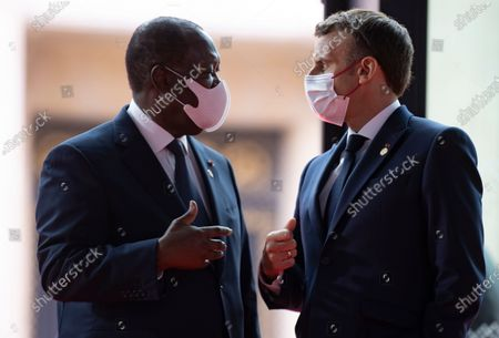 French President Emmanuel Macron (R) greets Ivory Coast's President Alassane Ouattara as he arrives at the Grand Palais Ephemere for the Financing of African Economies Summit, at the Champs de Mars in Paris, France, 18 May 2021.