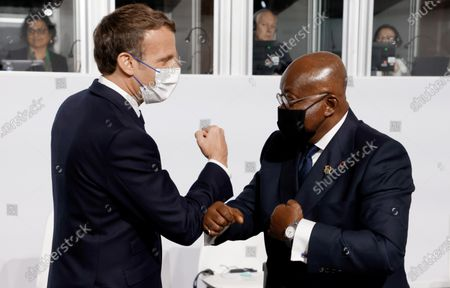 French President Emmanuel Macron (L) salutes Ghana's President Nana Akufo-Addo (R) before the opening session of the Summit on the Financing of African Economies in Paris, France, 18 May 2021.
