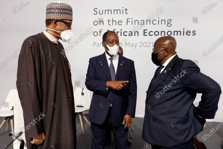 (L-R) Nigeria's President Muhammadu Buhari, Ivory Coast President Alassane Ouattara and Ghana's President Nana Akufo-Addo speak before the opening session of the Summit on the Financing of African Economies in Paris, France, 18 May 2021.