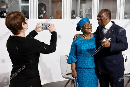 The Director-General of the World Trade Organization Ngozi Okonjo-Iweala (L) poses with Ivory Coast President Alassane Ouattara (R) before the opening session of the Summit on the Financing of African Economies in Paris, France, 18 May 2021.
