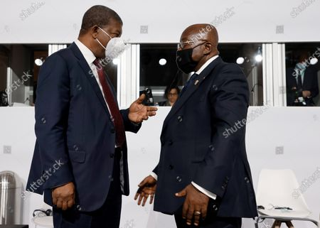 Angola's President Joao Lourenco (L) and Ghana's President Nana Akufo-Addo (R) speak before the opening session of the Summit on the Financing of African Economies in Paris, France, 18 May 2021.