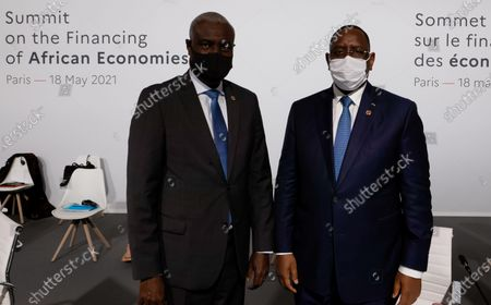 African Union (AU) Commission Chairman Moussa Faki (L) and Senegal's President Macky Sall (R) pose before the opening session of the Summit on the Financing of African Economies in Paris, France, 18 May 2021.