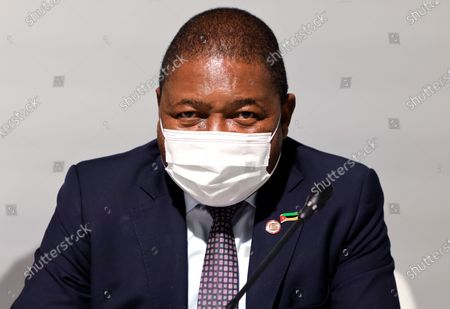 Mozambique's President Filipe Nyusi poses before the opening session of the Summit on the Financing of African Economies in Paris, France, 18 May 2021.