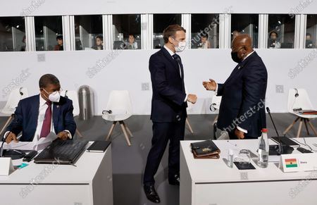 French President Emmanuel Macron (C) salutes Ghana's President Nana Akufo-Addo (R) as Angola's President Joao Lourenco looks on before the opening session of the Summit on the Financing of African Economies in Paris, France, 18 May 2021.