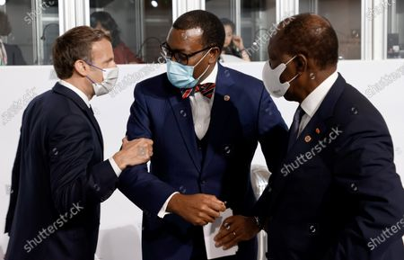 French President Emmanuel Macron (L) salutes the president of the African Development Bank Akinwumi Adesina (C) and Ivory Coast President Alassane Ouattara (R) before the opening session of the Summit on the Financing of African Economies in Paris, France, 18 May 2021.