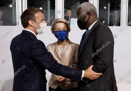 Stock Image of French President Emmanuel Macron (L) salutes European Commission President Ursula von der Leyen (C) and African Union (AU) Commission Chairman Moussa Faki (R) before the opening session of the Summit on the Financing of African Economies in Paris, France, 18 May 2021.