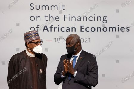 Nigeria's President Muhammadu Buhari (L) speaks with African Union (AU) Commission Chairman Moussa Faki (R) before the opening session of the Summit on the Financing of African Economies in Paris, France, 18 May 2021.