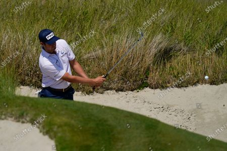 Harris English hits from the bunker on the 13th hole during a practice round at the PGA Championship golf tournament on the Ocean Course, in Kiawah Island, S.C