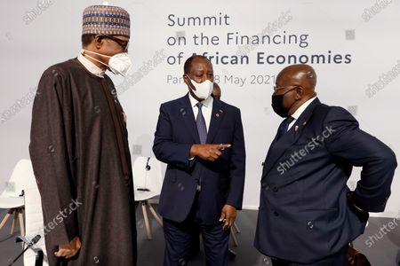 From left, Nigeria's President Muhammadu Buhari, Ivory Coast President Alassane Ouattara and Ghana's President Nana Akufo-Addo chat before the opening session at the Summit on the Financing of African Economies in Paris. More than twenty heads of state and government from Africa are holding talks in Paris with heads of international organizations on how to revive the economy of the continent, deeply impacted by the consequences of the COVID-19 pandemic