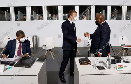 French President Emmanuel Macron salutes Ghana's President Nana Akufo-Addo before the opening session at the Summit on the Financing of African Economies in Paris. More than twenty heads of state and government from Africa are holding talks in Paris with heads of international organizations on how to revive the economy of the continent, deeply impacted by the consequences of the COVID-19 pandemic