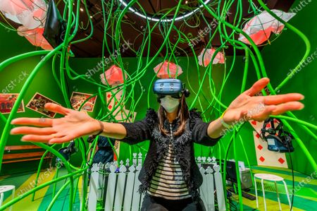 A Virtual Reality station, developed in collaboration with HTC VIVE Arts - inviting visitors to play flamingo croquet - Alice: Curiouser and Curiouser exhibition at the V&A, opens as lockdown eases further. Celebrating the iconic, imaginative and inspiring story.The V&A is the first museum to fully explore the cultural impact of Alice in Wonderland and its ongoing inspiration for leading creatives, from Salvador Dalí and Yayoi Kusama, to The Beatles, Vivienne Westwood and Little Simz. The exhibition is designed by award-winning designerTomPiper- best known for his stage designs for the Royal Shakespeare Company and the V&A as well as his Tower of London poppies installation.