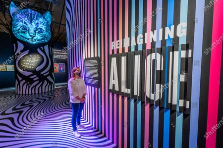 Reimagining Alice with the Cheshire Cat - A 'looking glass' inspired digital art installation, encouraging visitors to imagine their own wonderlands - Alice: Curiouser and Curiouser exhibition at the V&A, opens as lockdown eases further. Celebrating the iconic, imaginative and inspiring story.The V&A is the first museum to fully explore the cultural impact of Alice in Wonderland and its ongoing inspiration for leading creatives, from Salvador Dalí and Yayoi Kusama, to The Beatles, Vivienne Westwood and Little Simz. The exhibition is designed by award-winning designerTomPiper- best known for his stage designs for the Royal Shakespeare Company and the V&A as well as his Tower of London poppies installation.