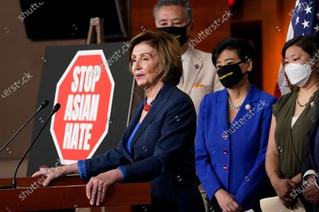 House Speaker Nancy Pelosi of Calif., left, speaks during a news conference on Capitol Hill in Washington, on the COVID-19 Hate Crimes Act. Pelosi is joined by Rep. Mark Takano, D-Calif., second from left, Rep. Judy Chu, D-Calif., second from right and Rep. Grace Meng, D-N.Y