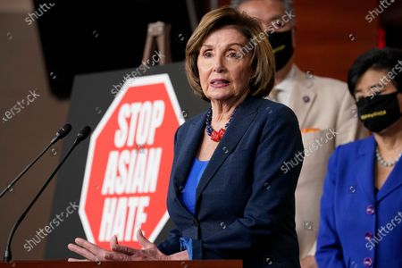 House Speaker Nancy Pelosi of Calif., left, speaks during a news conference on Capitol Hill in Washington, on the COVID-19 Hate Crimes Act. Pelosi is joined by Rep. Mark Takano, D-Calif., center, and Rep. Judy Chu, D-Calif