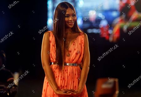 British model Naomi Campbell attends ARISE Fashion Week event in Lagos, Nigeria. Naomi Campbell says she has become mother to a baby girl. The 50-year-old supermodel announced the news Tuesday, May 18, 2021 on Instagram, posting a picture of her hand holding a baby's feet