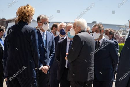 Mattarella with vice president of Lombardy Letizia Moratti (left) and president of Lombardy Attilio Fotana (right) visit the hub vaccination center in Brescia, Italy on May 18, 2021.