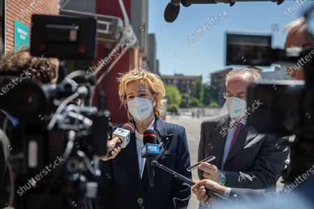 Vice President of Lombardy Letizia Moratti speaks with journalist during the visit of President of Italy Sergio Mattarella (not in picture) at the hub vaccination center in Brescia, Italy on May 18, 2021.