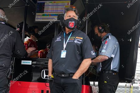 Car owner Michael Andretti watches from the pit area during practice for the Indianapolis 500 auto race at Indianapolis Motor Speedway in Indianapolis