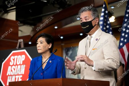 United States Representative Judy Chu (Democrat of California), left, listens as United States Representative Mark Takano (Democrat of California), offers remarks on the COVID-19 Hate Crimes Act during a press conference at the US Capitol in Washington, DC,.