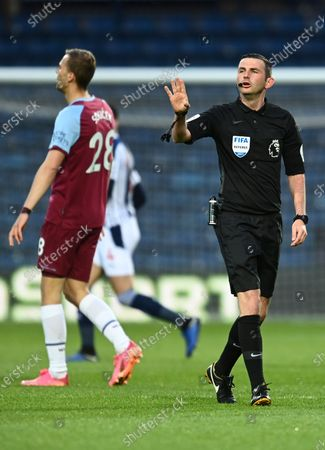 Referee Michael Oliver reacts