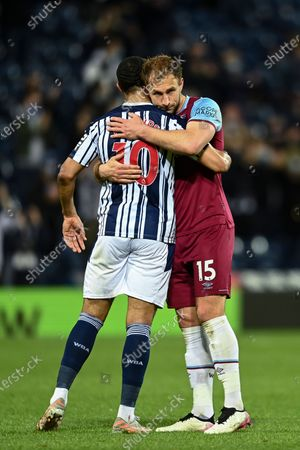 Stock Picture of Craig Dawson of West Ham United hugs Matt Phillips of West Bromwich Albion at full-time