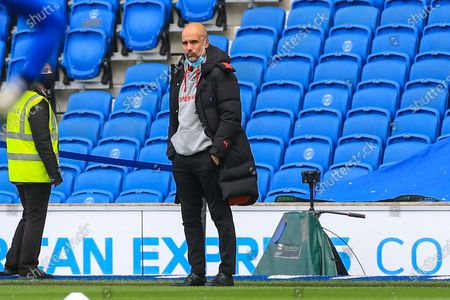 Manchester City manager Josep Guardiola during the Premier League match between Brighton and Hove Albion and Manchester City at the American Express Community Stadium, Brighton and Hove