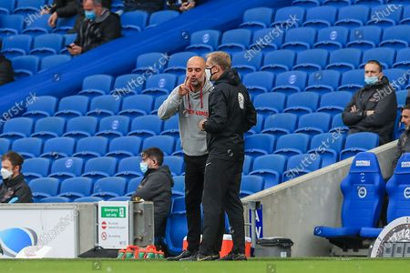 Manchester City manager Josep Guardiola argues with official gestures during the Premier League match between Brighton and Hove Albion and Manchester City at the American Express Community Stadium, Brighton and Hove
