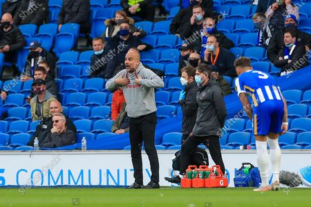 Manchester City manager Josep Guardiola gestures during the Premier League match between Brighton and Hove Albion and Manchester City at the American Express Community Stadium, Brighton and Hove