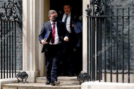 Lord Chancellor and Secretary of State for Justice Robert Buckland, Conservative Party MP for South Swindon, followed by Minister for Crime and Policing Kit Malthouse, Conservative Party MP for North West Hampshire, leave 10 Downing Street in London, England, on May 18, 2021.