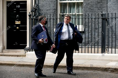 Lord Chancellor and Secretary of State for Justice Robert Buckland (L), Conservative Party MP for South Swindon, and Minister for Crime and Policing Kit Malthouse (R), Conservative Party MP for North West Hampshire, leave 10 Downing Street in London, England, on May 18, 2021.