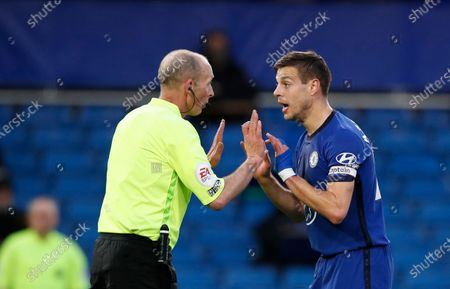 Referee Mike Dean, left, discusses with Chelsea's Cesar Azpilicueta during the English Premier League soccer match between Chelsea and Leicester City at Stamford Bridge Stadium in London