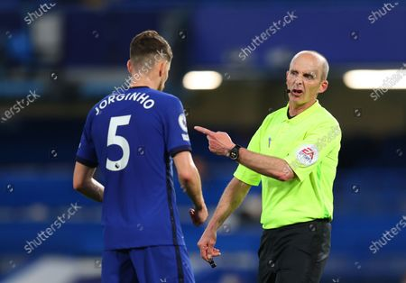 Referee Mike Dean, right, discusses with Chelsea's Jorginho during the English Premier League soccer match between Chelsea and Leicester City at Stamford Bridge Stadium in London