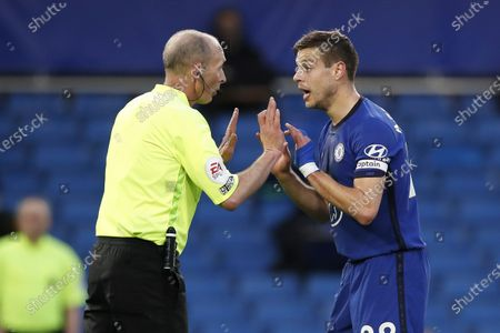 Chelsea's Cesar Azpilicueta (R) argues with referee Mike Dean (L) during the English Premier League soccer match between Chelsea FC and Leicester City in London, Britain, 18 May 2021.