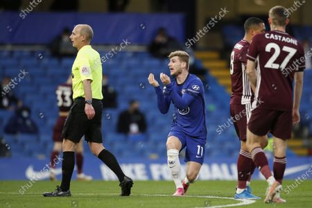 Chelsea's Timo Werner (C) argues with the referee Mike Dean (L) during the English Premier League soccer match between Chelsea FC and Leicester City in London, Britain, 18 May 2021.
