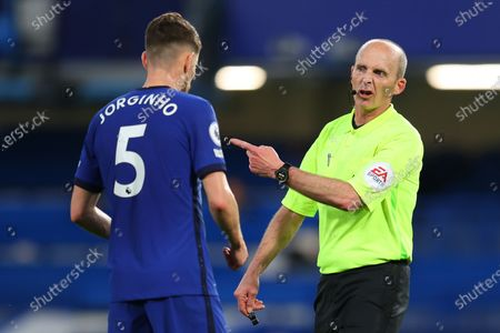 Referee Mike Dean (R) reacts to Chelsea's Jorginho (L) during the English Premier League soccer match between Chelsea FC and Leicester City in London, Britain, 18 May 2021.