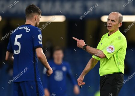 Referee Mike Dean (R) talks to Chelsea's Jorginho (L) during the English Premier League soccer match between Chelsea FC and Leicester City in London, Britain, 18 May 2021.