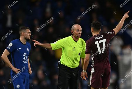 Stock Picture of Leicester's Ayoze Perez (R) talks to referee Mike Dean (C) during the English Premier League soccer match between Chelsea FC and Leicester City in London, Britain, 18 May 2021.