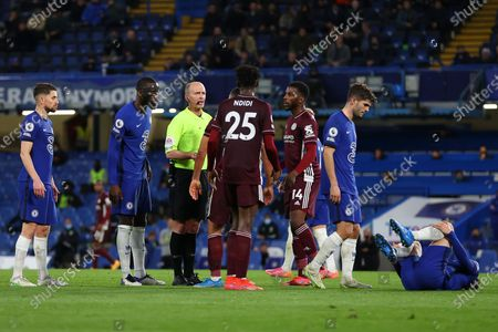 Stock Photo of Referee Mike Dean (3-L) reacts during the English Premier League soccer match between Chelsea FC and Leicester City in London, Britain, 18 May 2021.