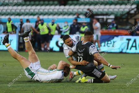 Newcastle Falcons's Luther Burrell  is stopped by Mike Haywood and Matt Proctor during the Gallagher Premiership match between Newcastle Falcons and Northampton Saints at Kingston Park, Newcastle on Monday 17th May 2021. (Credit: Mark Fletcher   MI News)