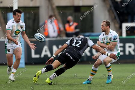 Northampton Saints' Rory Hutchinson offloads to George Furbank under pressure from Newcastle Falcons's Luther Burrell  during the Gallagher Premiership match between Newcastle Falcons and Northampton Saints at Kingston Park, Newcastle on Monday 17th May 2021. (Credit: Mark Fletcher   MI News)