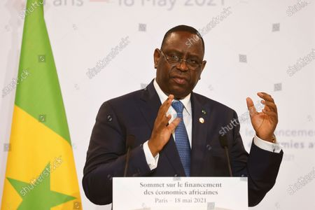 Senegal's President Macky Sall speaks during a joint press conference at the end of the Summit on the Financing of African Economies in Paris, France, 18 May 2021.