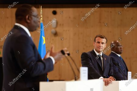 France's President Emmanuel Macron listens to Senegal's President Macky Sall as he speaks  during a joint press conference at the end of the Summit on the Financing of African Economies in Paris, France, 18 May 2021.