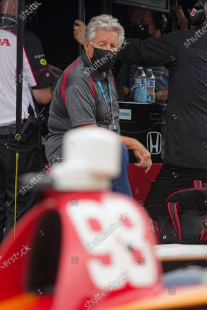 Mario Andretti watches as his grandson Marco Andretti practices for the Indianapolis 500 auto race at Indianapolis Motor Speedway in Indianapolis