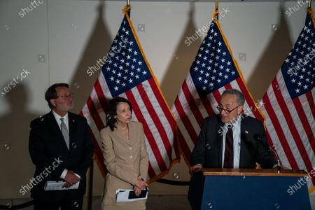 Sen. Gary Peters (D-MI), Sen. Maria Cantwell (D-WA) and Senate Majority Leader Chuck Schumer (D-NY) attend a news conference following a policy luncheon meeting with fellow Senate Democrats on Capitol Hill on May 18, 2021 in Washington, DC. (Kent Nishimura / Los Angeles Times)