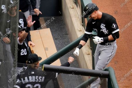 Chicago White Sox's Jake Lamb, right, gets a fist bump from manager Tony La Russa following his solo home run in the first inning of a baseball game, in Minneapolis