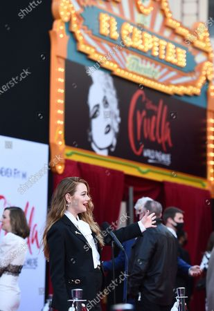 """Emma Stone speaks on the red carpet as she arrives at the premiere of """"Cruella"""" at the El Capitan Theatre, in Los Angeles"""