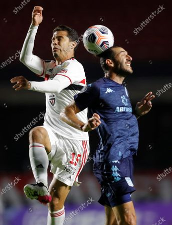 Anderson Hernanes de Carvalho from Sao Paulo disputes the ball against Ignacio Piatti from Racing during the Group E match between Sao Paulo of Brazil and Racing of Argentina of the Copa Libertadores, at the Morumbi Stadium in Sao Paulo, Brazil, 18 May 2021.