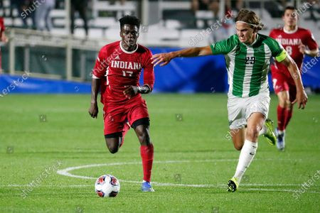Indiana's Herbert Endeley (17) is challenged by Marshall's Max Schneider (23) during the first half of the NCAA College Cup championship soccer match in Cary, N.C